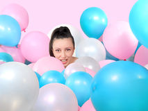 Portrait of woman surrounded by  balloons Royalty Free Stock Images