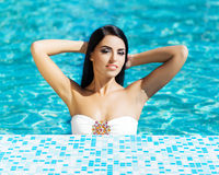 Portrait of a woman in the swimming pool Royalty Free Stock Images