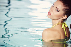 Portrait of a woman in swimming pool Royalty Free Stock Photo