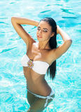 Portrait of a woman in the swimming pool Royalty Free Stock Photography