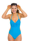 Portrait of woman in swimsuit with sunglasses Royalty Free Stock Image