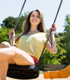 Portrait of a woman on swing Stock Photo