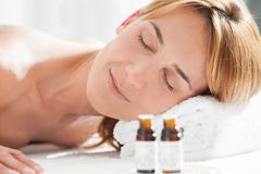 Woman on a table massage. Portrait of a woman on table massage with essentials oils Royalty Free Stock Photos