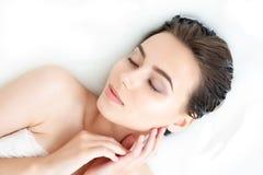 Portrait of woman taking spa bath. Skin beauty health care concept Stock Image