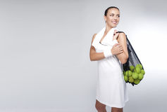 Portrait of a Woman With Tennis Balls in Mesh Posing in Studio. Royalty Free Stock Photography