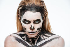 Portrait of woman with terrifying halloween makeup. Over white background Royalty Free Stock Photos