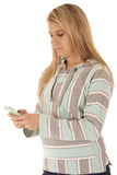 Portrait of a woman texting on her cell phone Stock Photos