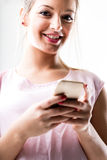 Portrait of a woman texting with her mobile Royalty Free Stock Photography