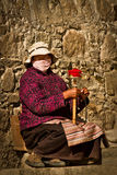 Portrait of a woman from Tibet with a prayer wheel Royalty Free Stock Photography