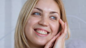 Portrait of woman touching her face stock footage