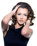 Portrait of woman touching herbeautiful curly hair Royalty Free Stock Images