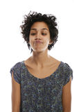 Portrait of woman toughing nose with tongue Royalty Free Stock Photography