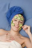Portrait of woman in towel and mask from cucumber Royalty Free Stock Photo