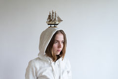 Portrait of a woman with a toy ship on her head Royalty Free Stock Photo