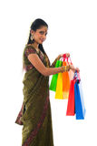 Portrait of a woman in traditional saree holding gifts and smili Stock Image
