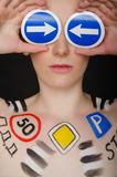 Portrait of woman with traffic signs Stock Photos