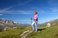 Portrait of a woman with trekking poles Royalty Free Stock Images