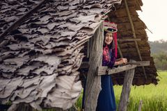 Portrait of Woman Tribal Lisu in Traditional Clothing and Jewelry Costume in Cottage., Lifestyle of Hill Tribe Girl in The North. Of Thailand., Asian Ethics royalty free stock image