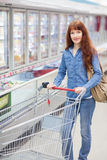Portrait of woman and trolley Royalty Free Stock Photos