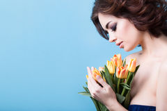 Portrait of a woman with tulips Royalty Free Stock Image