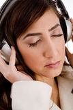 Portrait of woman tuned in music Royalty Free Stock Photo