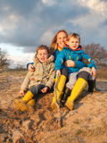 Portrait of woman and two small children in dune landscape Stock Photography