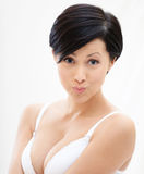 Portrait of woman in underwear puffing her cheeks Royalty Free Stock Photography