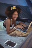 Portrait of woman using digital laptop Royalty Free Stock Image