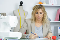 Portrait woman using electric sewing machine Royalty Free Stock Photography