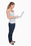 Portrait of a woman using a laptop Stock Photo