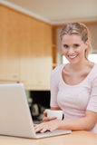 Portrait of a woman using a laptop while drinking coffee Royalty Free Stock Photo