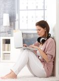 Portrait of woman using laptop at home Royalty Free Stock Images