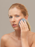 Portrait woman using metal dish scrubber face Stock Images