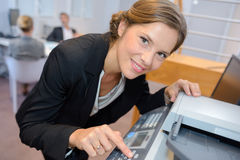 Portrait woman using photocopier Royalty Free Stock Images