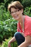 Portrait of woman in vegetable garden Stock Photo