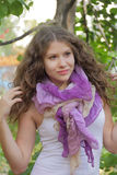Portrait of woman with violet scarf Royalty Free Stock Photos
