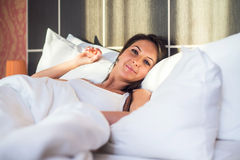 Portrait of woman waking up, resting  in bed early morning Stock Photography