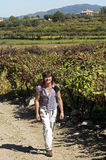 Portrait of woman walking among vineyards Portugal Royalty Free Stock Photo