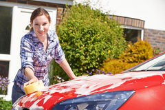 Portrait Of Woman Washing Car Royalty Free Stock Image
