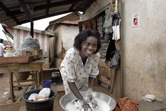 Portrait of woman washing clothes for her store Royalty Free Stock Photography