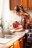Portrait of woman washing dishes on kitchen Royalty Free Stock Photo