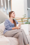 Portrait of a woman watching TV Royalty Free Stock Photo