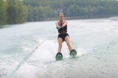 Portrait woman water skiing. Portrait of woman water skiing stock photography
