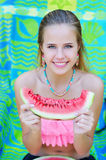 Portrait of a woman with watermelon slice Stock Photos
