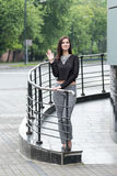Portrait of a woman waving hand Royalty Free Stock Photography