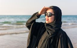 Portrait of a woman in abaya on the beach Stock Images