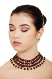 Portrait of a woman wearing beautiful necklace Royalty Free Stock Images