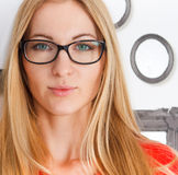 Portrait of the woman wearing black eye glasses. Looking at camera stock images