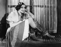Portrait of woman wearing cowboy boots. (All persons depicted are no longer living and no estate exists. Supplier grants that there will be no model release Stock Image
