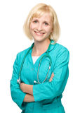 Portrait of a woman wearing doctor uniform Stock Photo